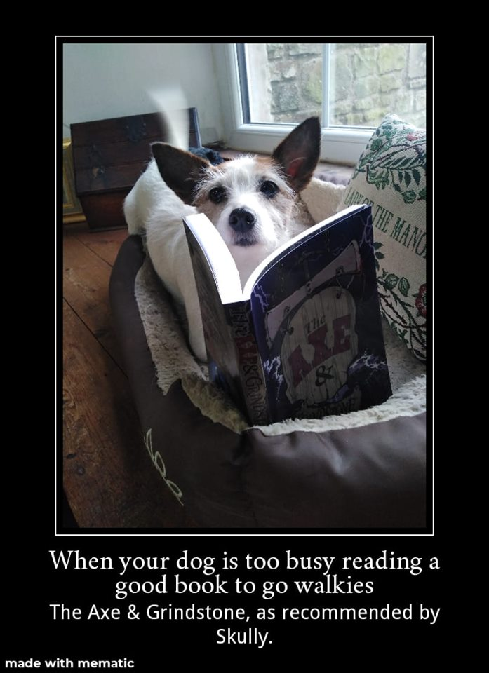 Skully reading The Axe & Grindstone